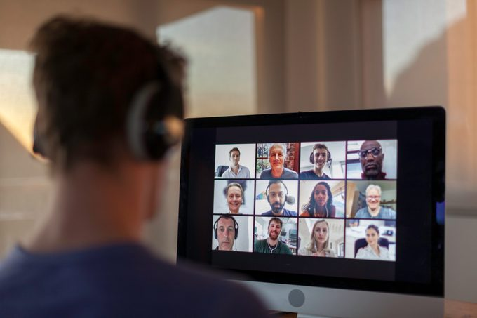 rearview of man on zoom video chat call on computer