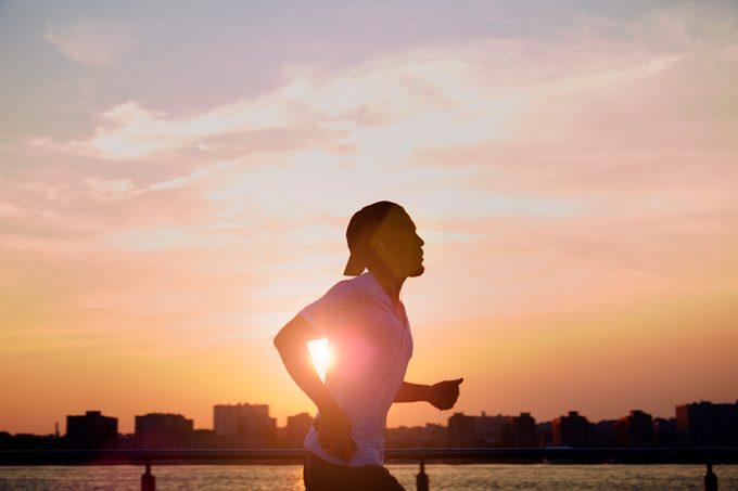 man enjoying an early morning jog during sunrise in the city
