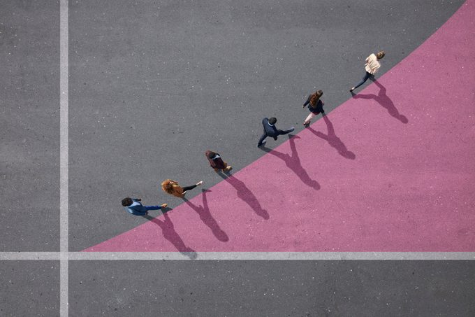 view from above of people walking on pink graph curve