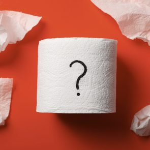 toilet paper roll with question mark on red background