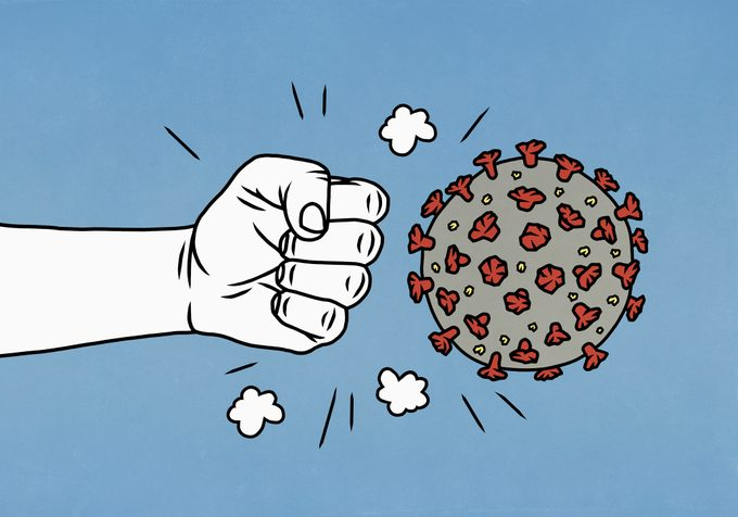 angry fist next to covid-19 virus illustration