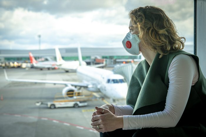 woman wearing a mask at the airport