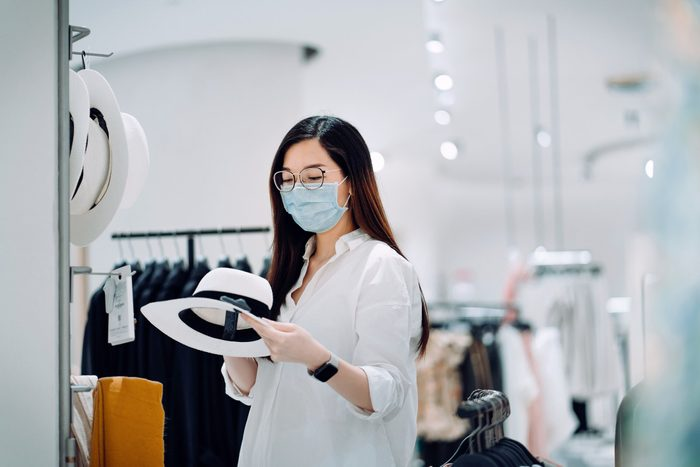 woman shopping while wearing a face mask