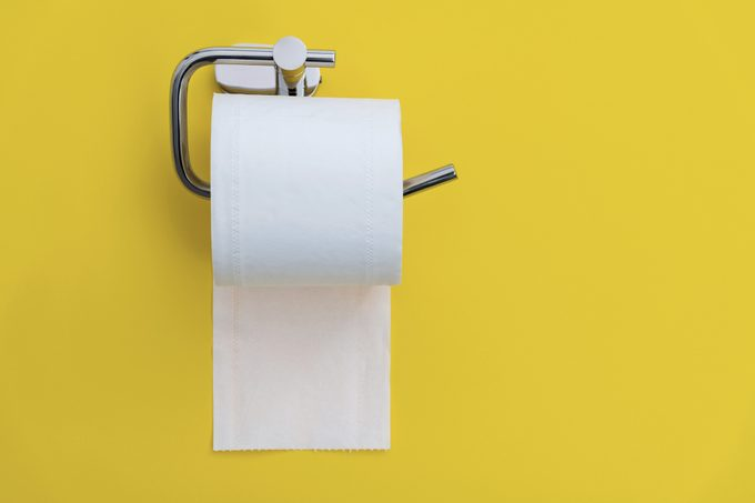 toilet paper holder on yellow background