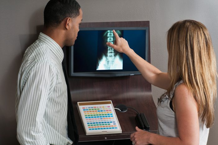 Chiropractor Showing Xrays to Patient