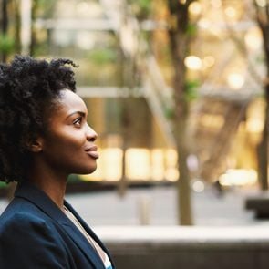 profile of young woman walking with confidence