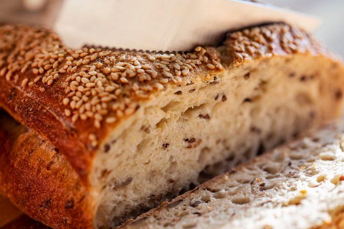 Close up of slicing bread
