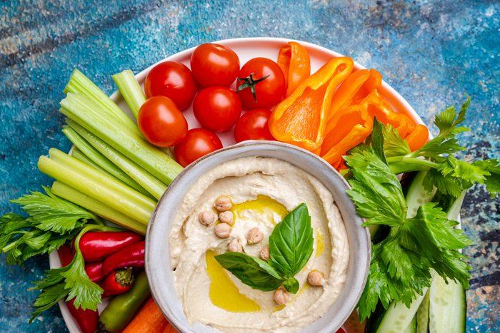 Hummus platter with assorted snacks.