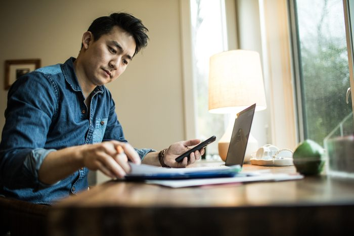 man working on finances at home