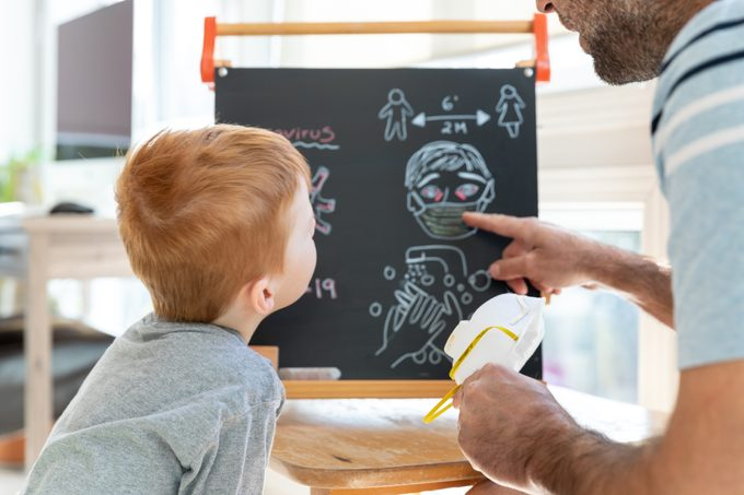 father teaching son about coronavirus pandemic