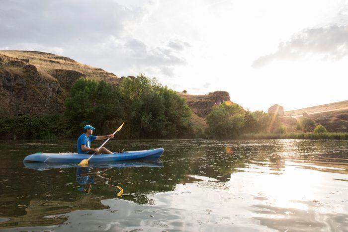 man kayaking in the sunshine