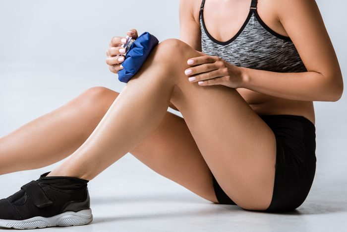 woman using ice for knee injury
