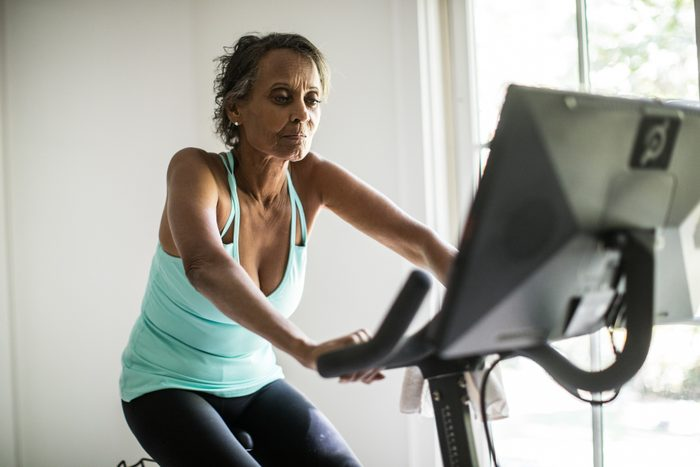 mature woman on exercise bike