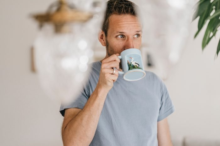 Man drinking coffee at home