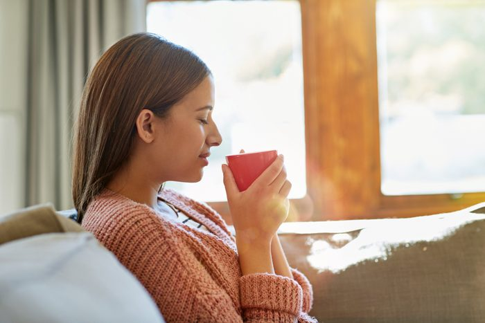 woman holding warm beverage