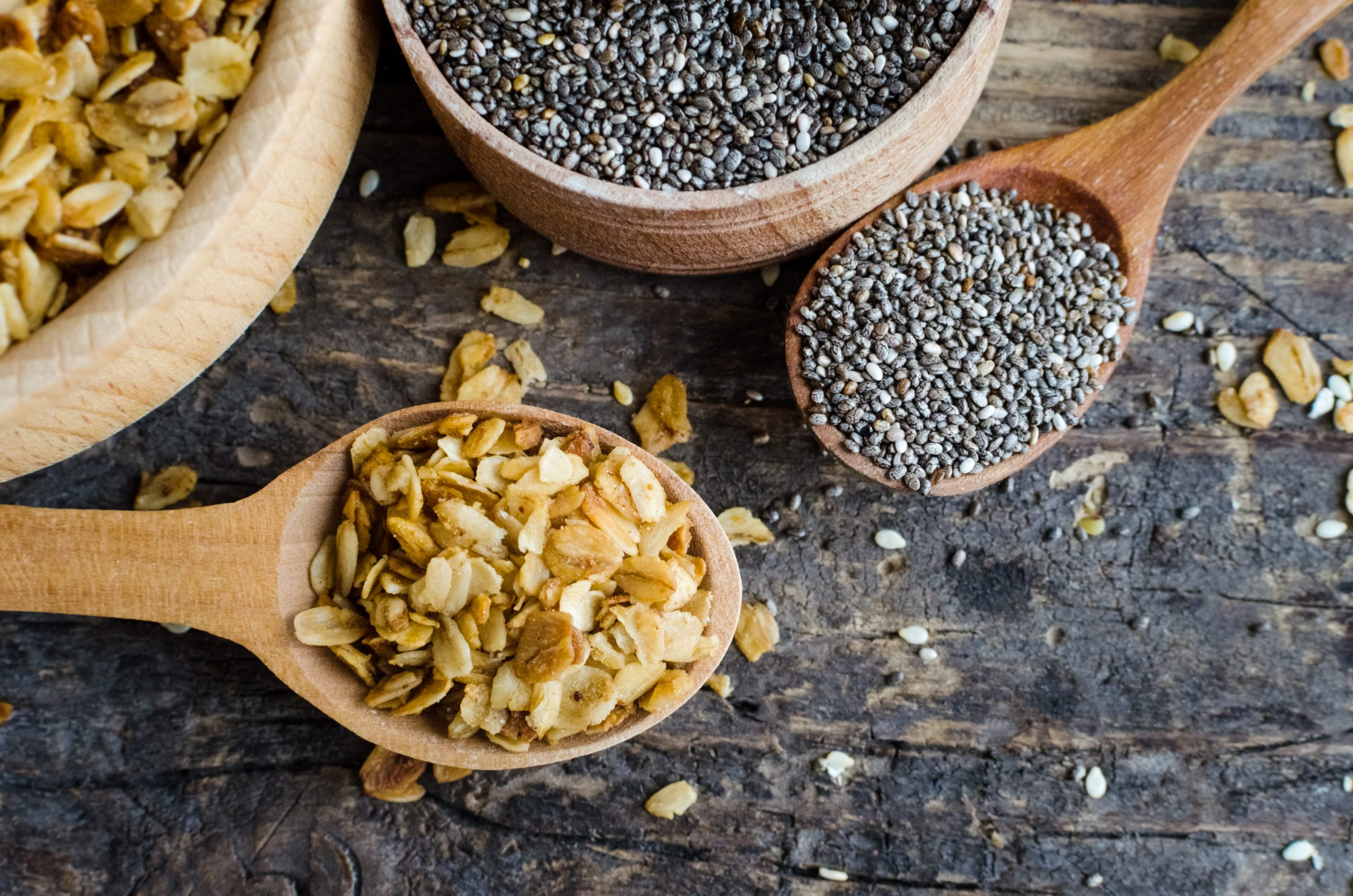 chia seeds and oats in wooden spoons