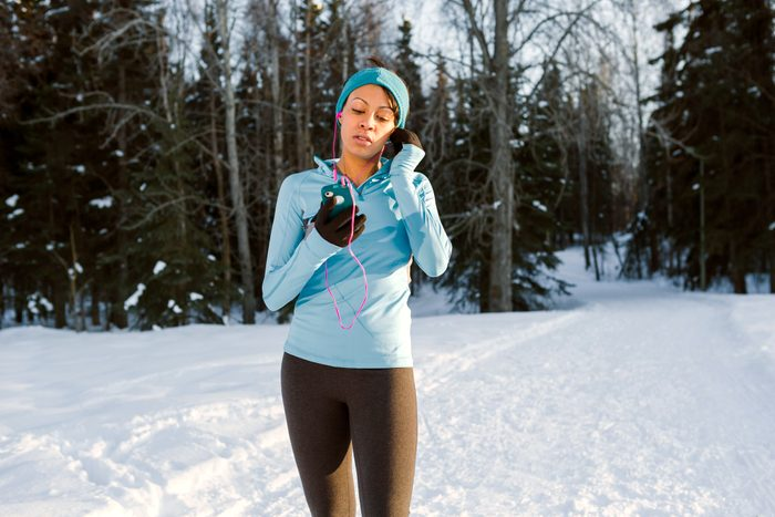 young woman going for exercise walk during the winter