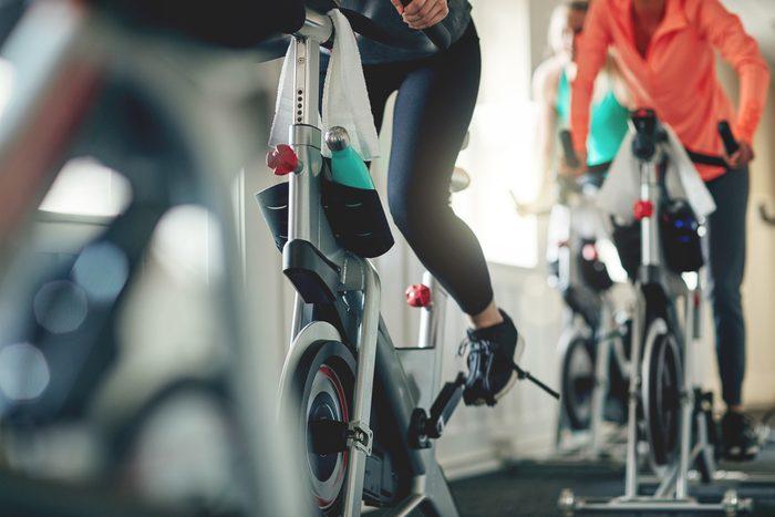 people riding indoor bikes