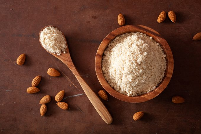 almond flour in wooden bowl and wooden spoon