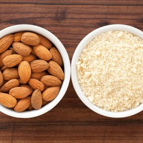 Almonds and almond flour in bowl