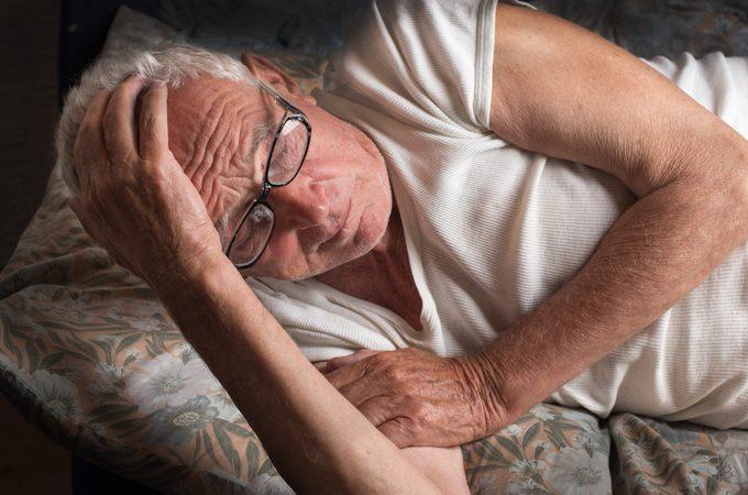 Senior man laying down