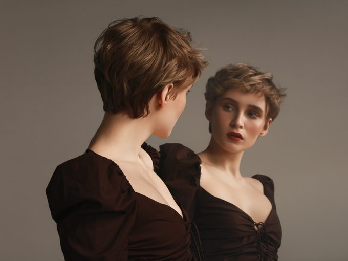 Young woman and her mirror reflection