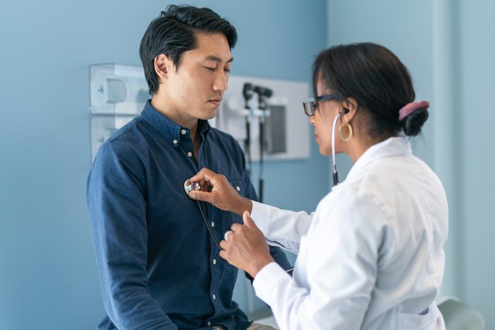 Korean man in consultation with doctor