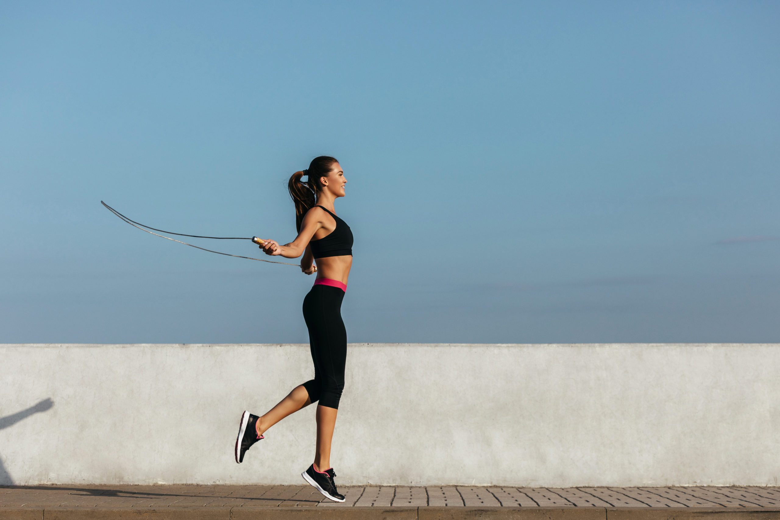 Young Woman Training With A Jumping Rope