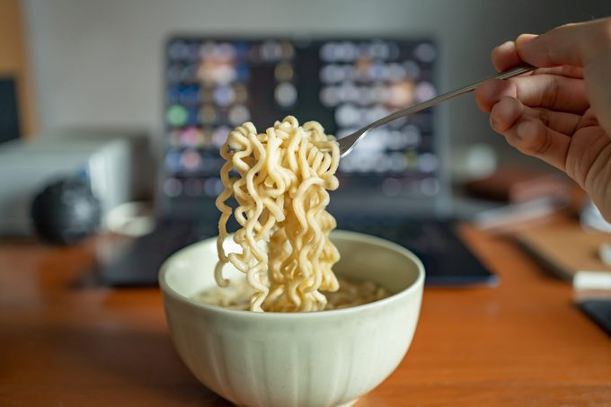 Eating instant noodle on a working table