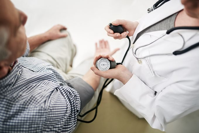 doctor measuring patient's blood pressure shot from above