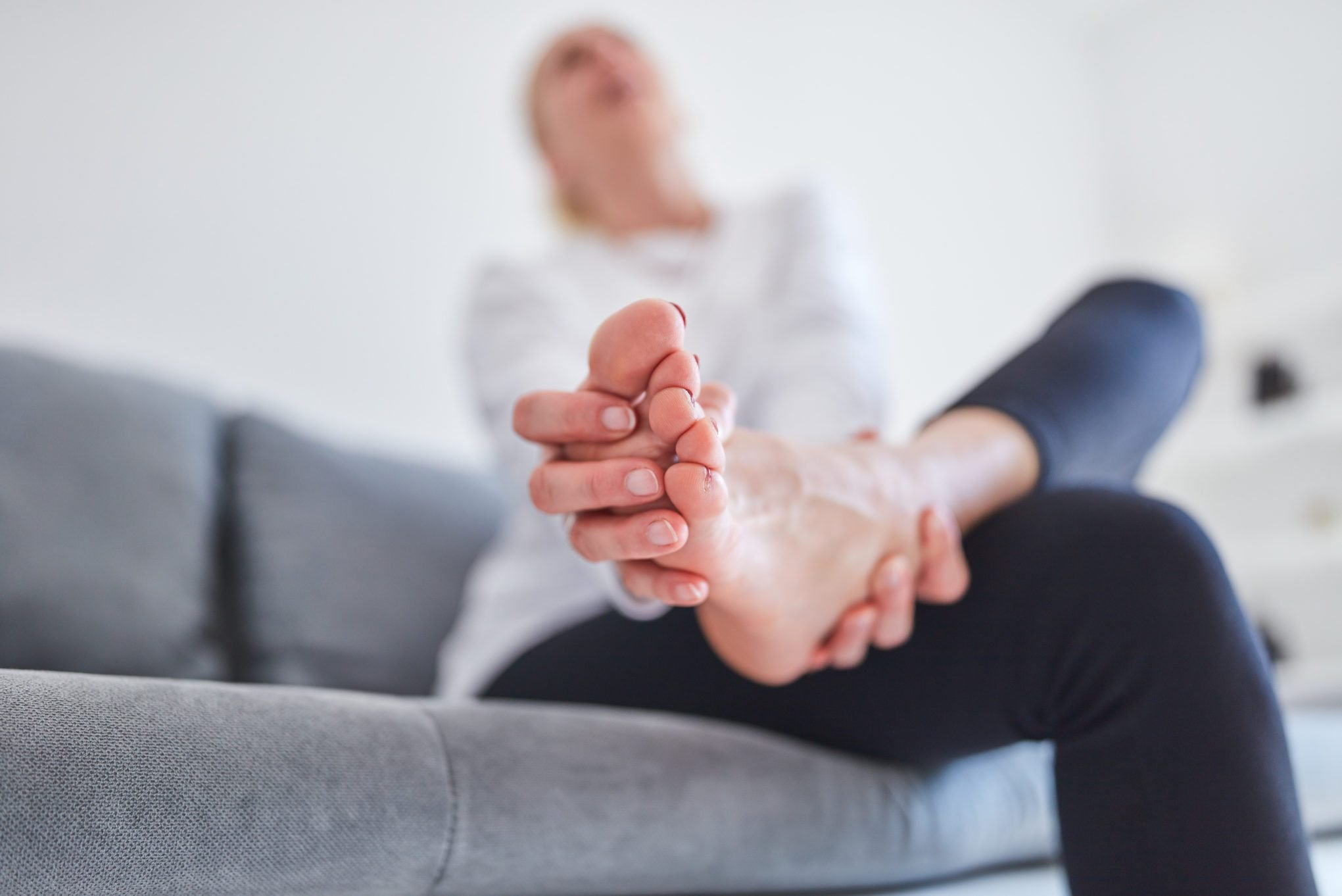 person holding foot