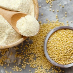 Hulled millet flour and grain top view