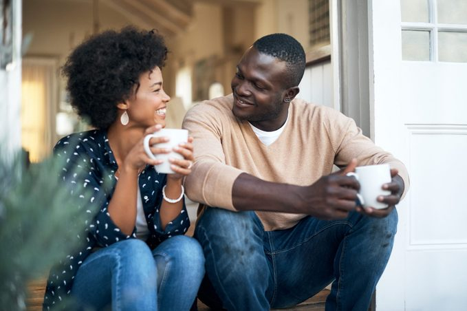 man and woman talking and drinking coffee and smiling