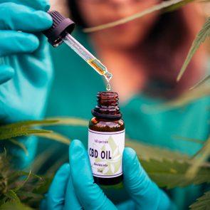 CBD oil tincture in woman's hands