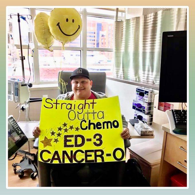 Ed Yakacki with chemo sign
