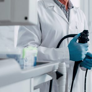 doctor holding endoscope for colonoscopy