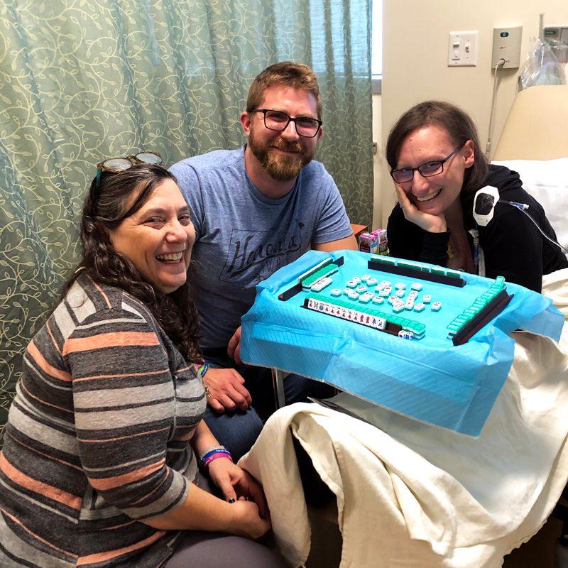 Janessa Schwartz in hospital beds with friends