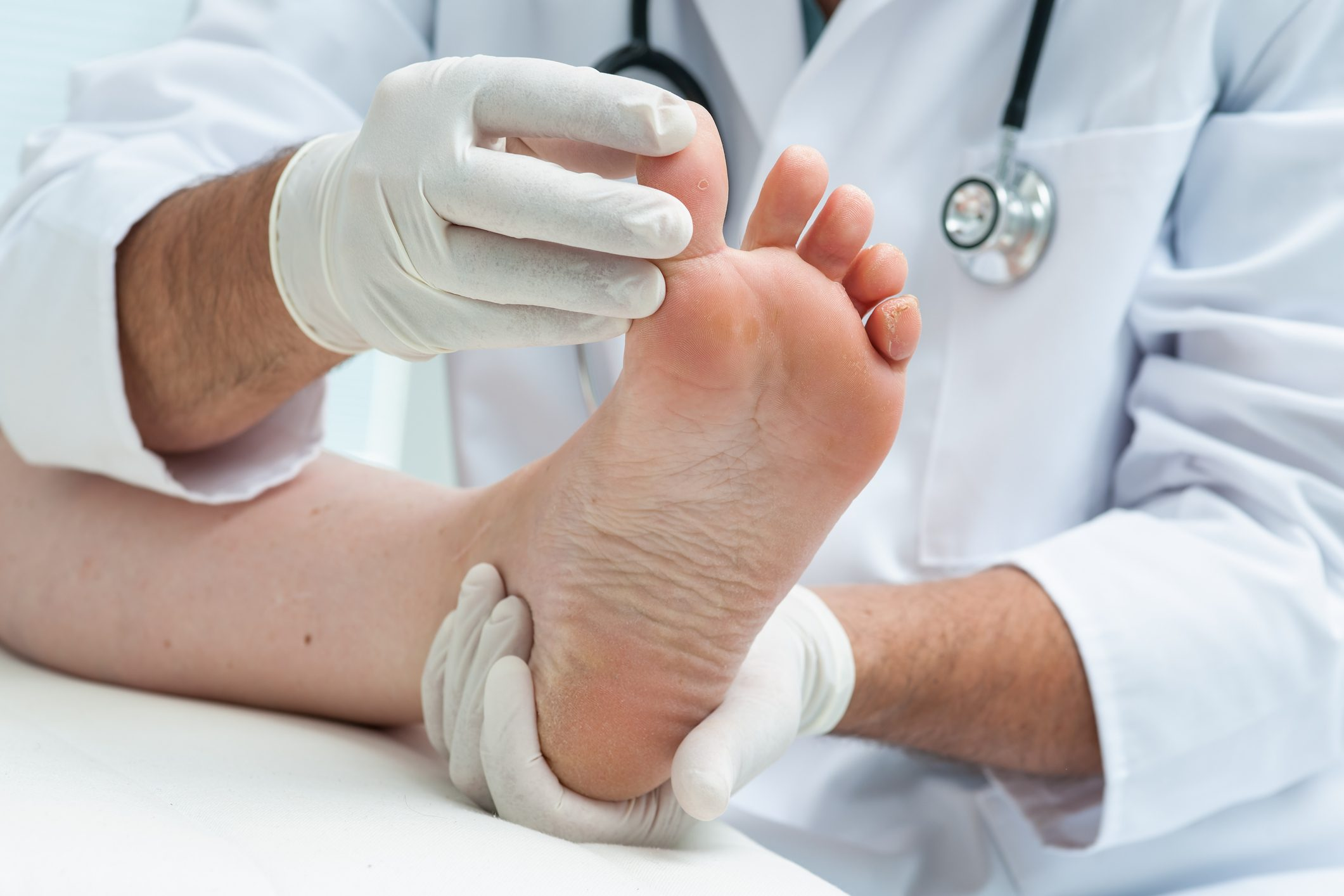 doctor holding patient's foot
