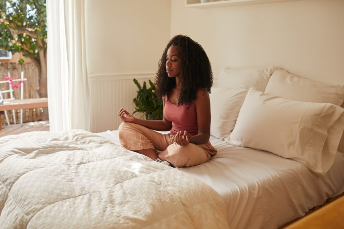 Young woman beginning her day with some meditation
