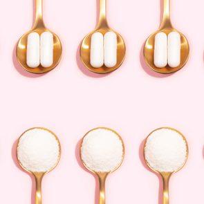 Collagen powder and pills on pink background