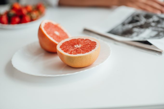 Close-Up Of Chopped Fruits In Plate On Table