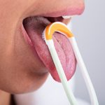 Do You Really Need a Tongue Scraper? What Dentists Say