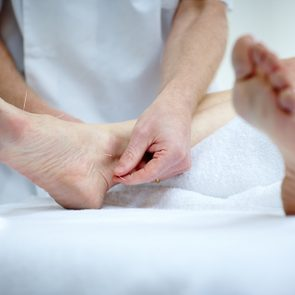 Woman's feet receiving acupuncture treatment