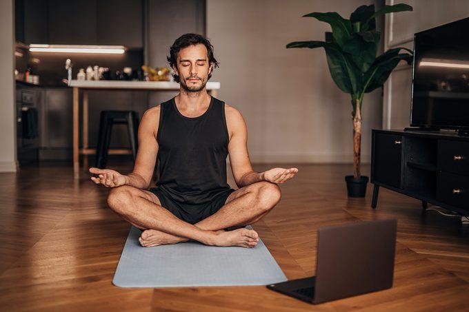 Man meditating in the living room