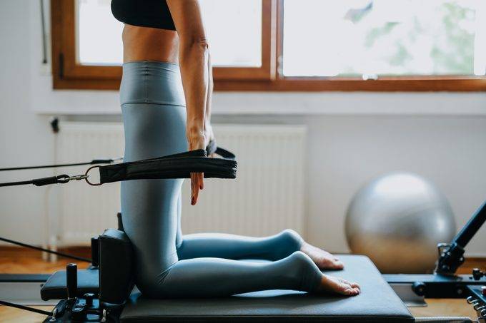 young sporty attractive woman practicing pilates yoga