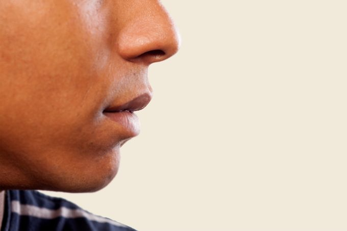close up of man's nose and mouth