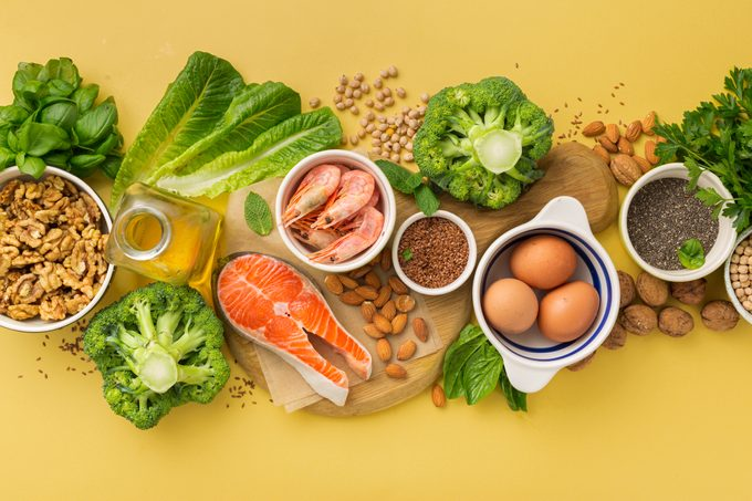 omega 3 and omega 6 food sources on yellow background