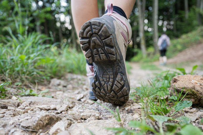 close up of woman's hiking shoes while walking on a hike