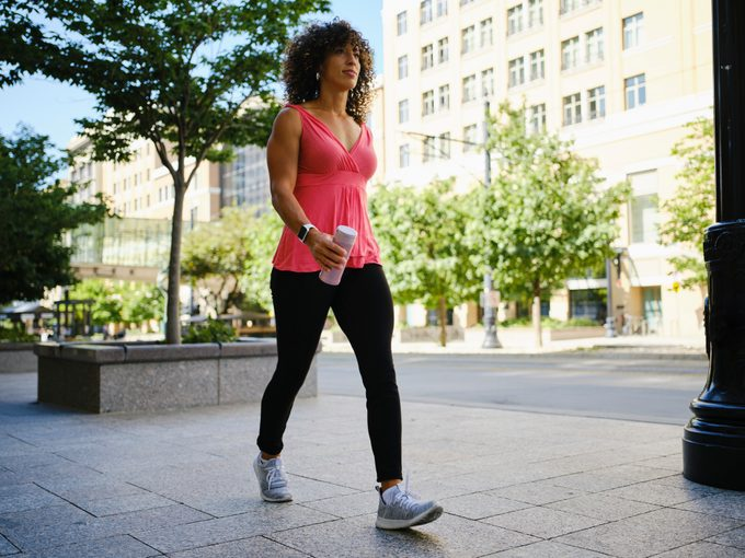Young Adult Woman Walking outside for exercise