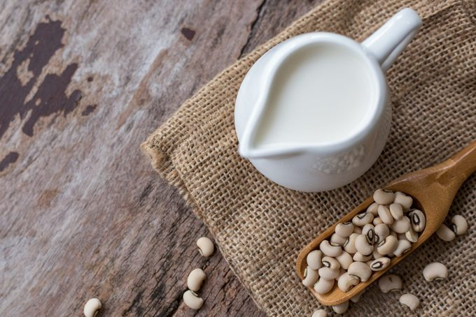 Soy milk and soy bean on wood table